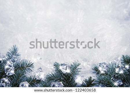 Winter backround with spruce branches and cubes of ice