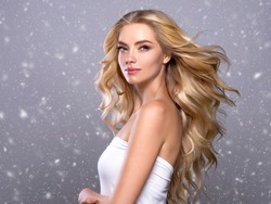 Winter beauty woman beautiful hair blonde snow snowflakes background