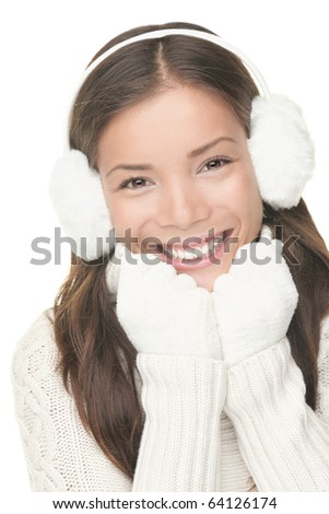 Winter beauty woman smiling playful, cute and happy looking at camera. Portrait of mixed Asian / Caucasian young woman isolated on white background