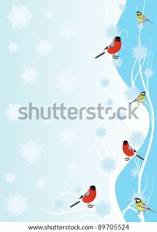 Winter birds on a branch against a background of falling snowflakes