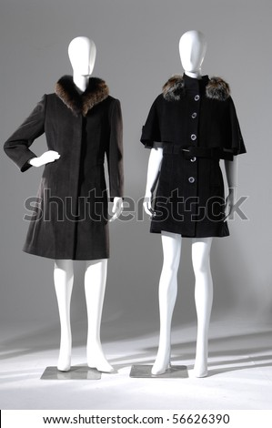 Winter black coat dress on mannequin