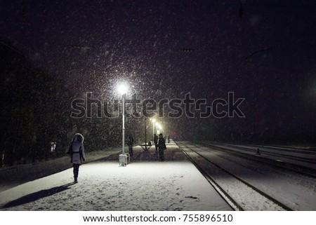 Winter blizzard at the railway station in evening #755896510