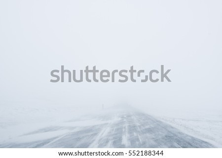 Winter Blizzard in the driving road in Iceland #552188344