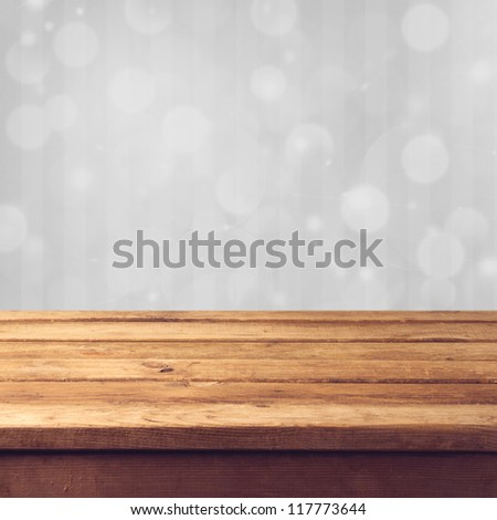 Winter bokeh background with wooden table