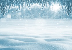 Winter bright background. Christmas background with deep snowdrifts and branches of trees in frost