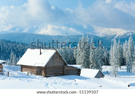 winter calm mountain landscape with shed and Goverla mount ridge behind (Kukol Mount, Carpathian Mountains, Ukraine)