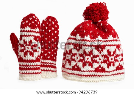 winter cap and mittens knitted with jackard and heart motifs. on white