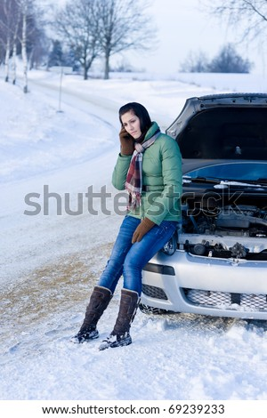 Winter car breakdown - woman call for help, road assistance