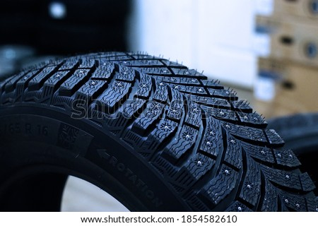 Photo of  winter car tire with spikes