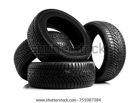 Winter car tires. Group of tires for winter driving on a white background. #751087384