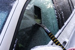Winter car window cleaning, Cleaning snow, Scraping ice,