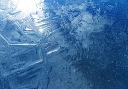 Winter card.Winter background, Frozen, blue ice texture.