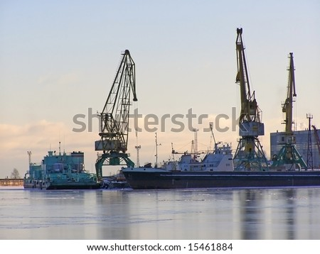 winter cargo side port with big ships and cranes