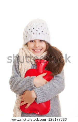 winter child hugging hot water bottle for warmth