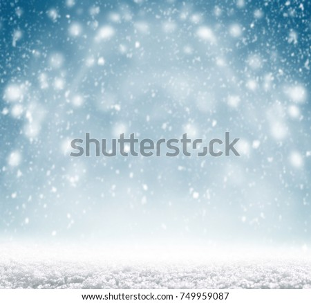 Winter christmas background with shiny snow and blizzard - Shutterstock ID 749959087