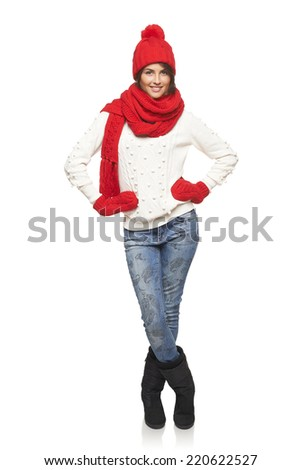 Stock Photo Winter, christmas, holidays concept. Smiling beautiful woman in red hat, scarf and mittens standing in full length over white background