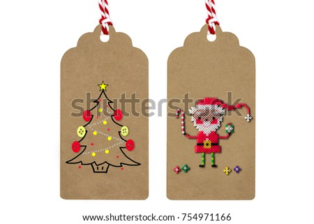 Winter & Christmas paper crafts,thank you card.Big christmas tree made from sewing buttons.Super cute Santa with candy cane and gift made from mini plastic beads.Top view, flat lay.White isolation. #754971166