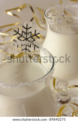 Winter cocktail at a christmas party, decorated cocktail glasses