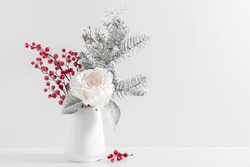 Winter composition, decoration, flowers, branches in vase on white background. Christmas, New Year, winter concept. Front view, copy space