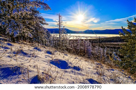 Winter dawn in the mountains. Winter mountain snow at dawn. Dawn in winter snow mountains