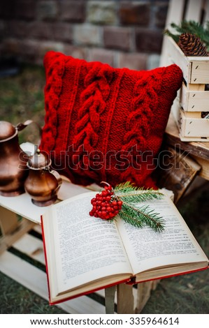 winter decor, pillow, kettle, book, box outdoors