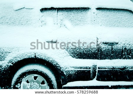 Winter driving conditions. Snow storm, snow tires,driving hazards and weather concept.