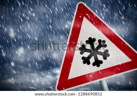 winter driving - warning sign - risk of snow and ice  #1288690852