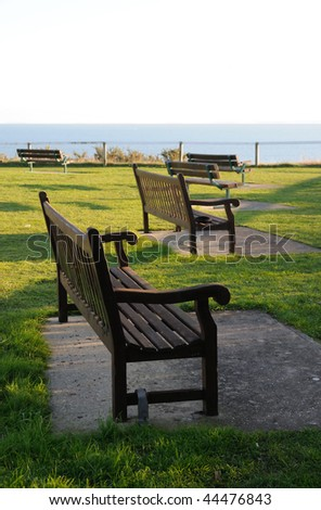 Winter - empty wooden benches on the clifftop at Bournemouth, UK
