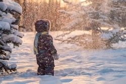 Winter fairytale. Portrait of a small boy waiting for miracle