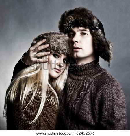 Winter fashion beautiful man and woman studio photo shooting