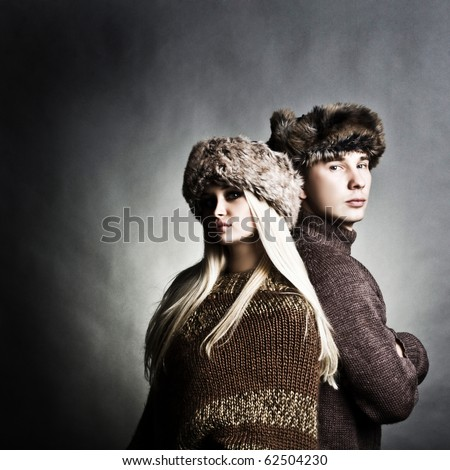Winter fashion beautiful man and woman studio photo shooting