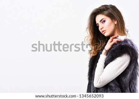 Winter fashion concept. Silver fur vest fashionable clothing. Luxury furry accessory. Girl makeup face long hairstyle wear fur vest white background. Fashion trend winter clothes. Boutique luxury fur.