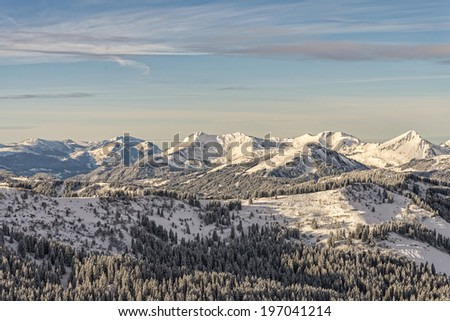 Winter forest on mountain range in French Alps #197041214