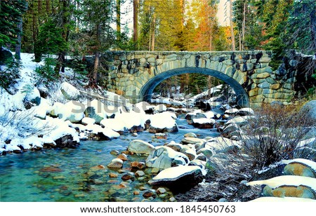 Winter forest river bridge snow. Arched stone bridge in winter forest. Forest river bridge. River bridge in snowy forest