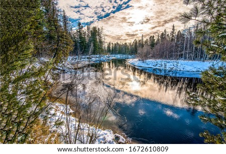 Winter forest river sunset scene. Sunset winter snow forest river. Forest river in winter sunset scene. Winter snow forest river sunset landscape