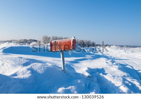winter frozen mail box under snow