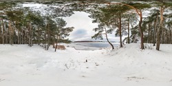 Winter full spherical seamless panorama 360 degrees angle view on road in a snowy park with gray pale sky near frozen lake in equirectangular projection. VR AR content