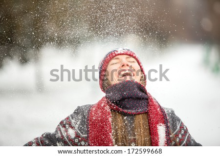 Winter fun woman playful during winter holidays vacation outside in snow forest. Romantic young woman enjoy snowfall with closed eyes