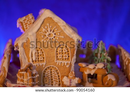 winter gingerbread house in the blue background.