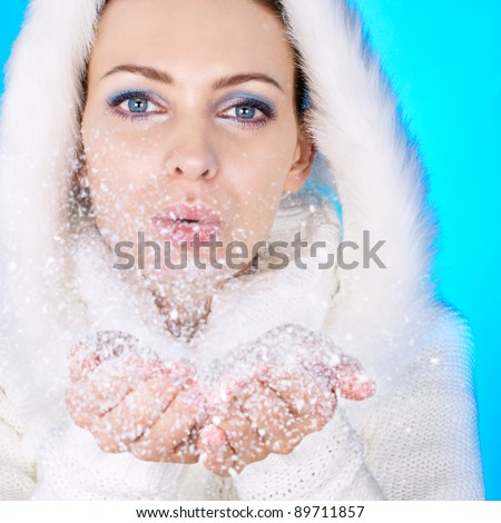 Winter girl and snow flakes. Focus on eyes. - stock photo