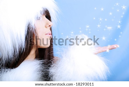 Winter Girl wearing white fur  . snow flake blue  background.