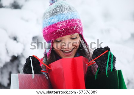 winter girl with gift bags