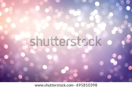 Winter glitter holiday purple blue pink background. Frosty bokeh luxurious natural texture. Glare blurred empty background. Festive glitter texture.