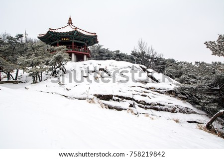 Winter Goguryeojeong Pavilion of Achasan with white snow piled up.(sign board text is
