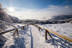 winter going over the high mountain and skies and snowboard paths covered by snow - landscape of Bieszczady Mountains