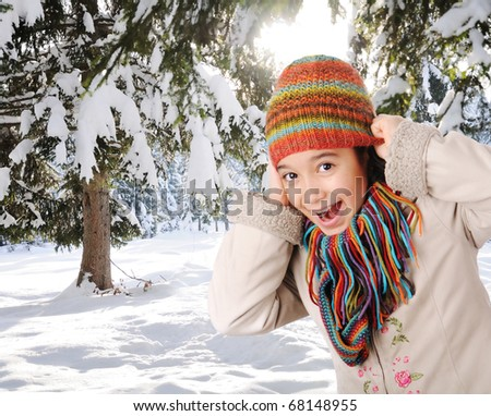 Winter happiness, girl in mountain forest smiling