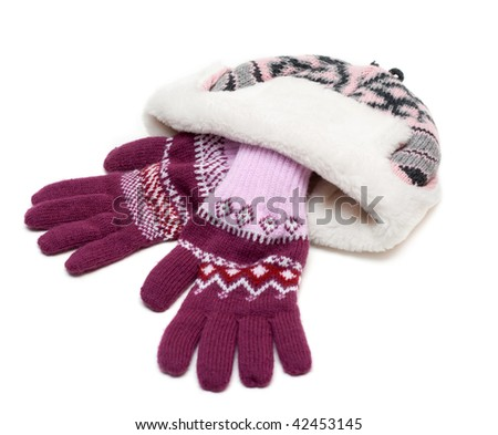Winter hat with fur and violet gloves on white background