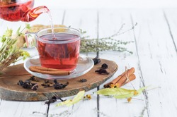Winter herbs and spices tea in glass teapot or mug, alternative medicine for the immune system, herbal hot drink concept