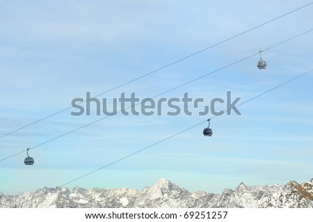 Winter Holiday Gondola Ski Lift Above Alps Mountains