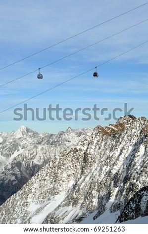 Winter Holiday Gondola Ski Lift Above Alps Mountains